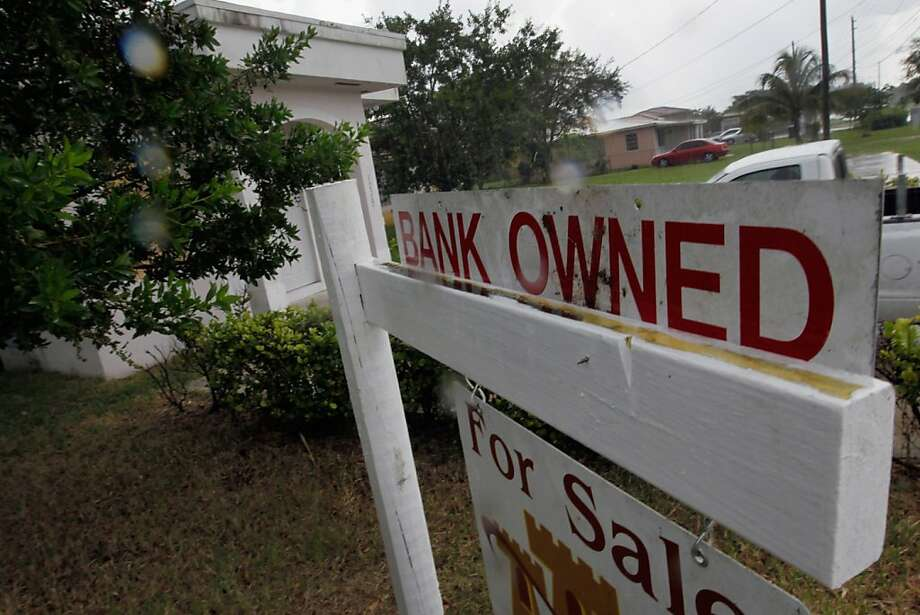 MIAMI, FL - OCTOBER 13:  A bank owned sign is seen in front of a foreclosed home on October 13, 2011 in Miami, Florida. RealtyTrac released a report that indicated that more homes were being foreclosured on in the third quarter of 2011. The report shows that there is evidence that the recent downward trend in foreclosures due to problems that surfaced with the way many lenders were handling foreclosure paperwork,  is about to change direction, with foreclosure activity slowly beginning to ramp back up.  (Photo by Joe Raedle/Getty Images) Photo: Joe Raedle, Getty Images