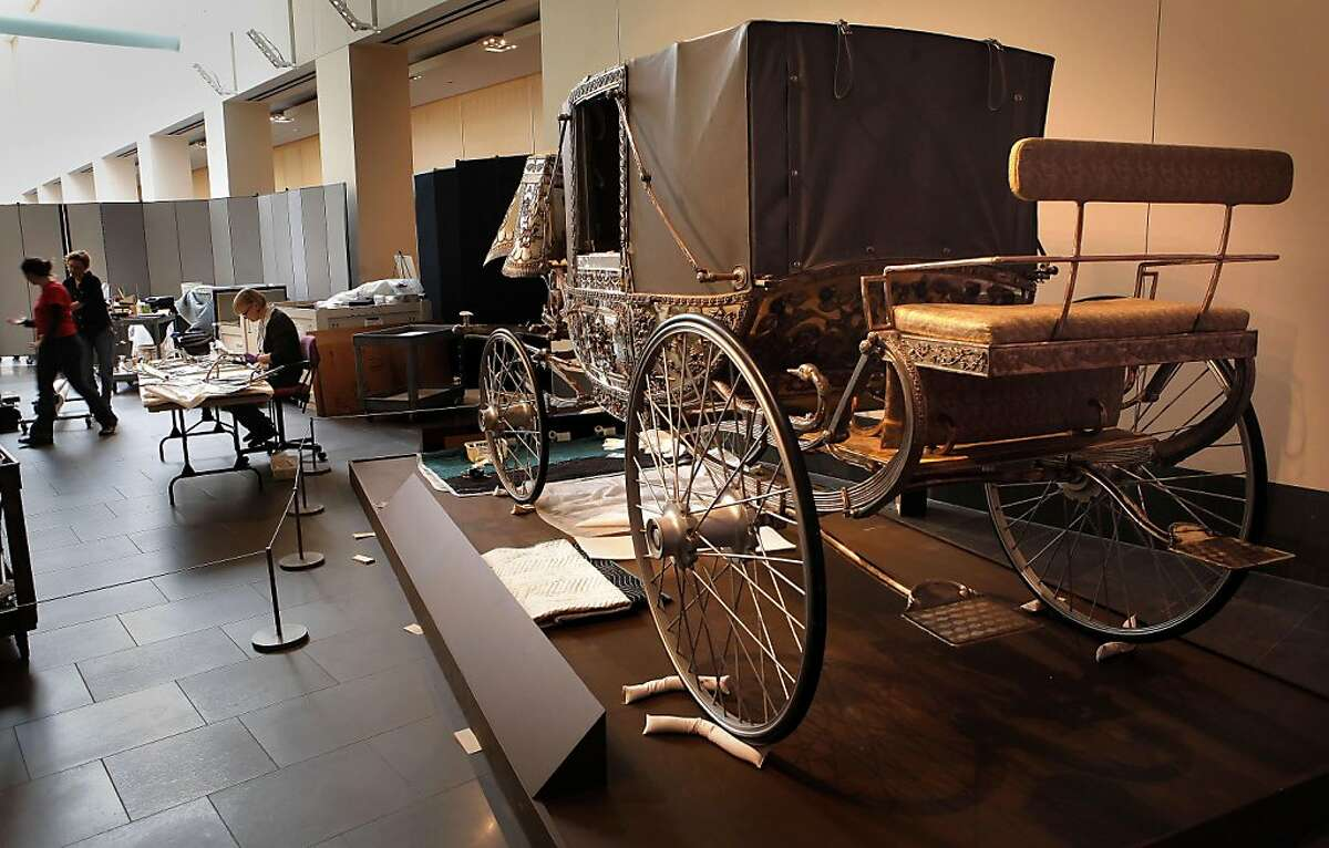 A silver coach built in 1907 by the Bombay Coach co., was once used by the Maharaja of the Kingdom of Bhavnagarpar India, part of new exhibit, Maharaja:The Splendor of India's Royal Courts, being installed at the Asian Art Museum, on Friday October 7, 2011, in San Francisco, Ca. This is first time the coach will be on display in the United States. The Asian Art Museum, faced with a financial crisis, entered into a deal that makes the city of San Francisco liable for its $98 million debt. Now owners say they're trying to turn the museum around with exhibitions designed to appeal to a larger audience, including one drawn up by Pixar animator, Sanjay Patel.