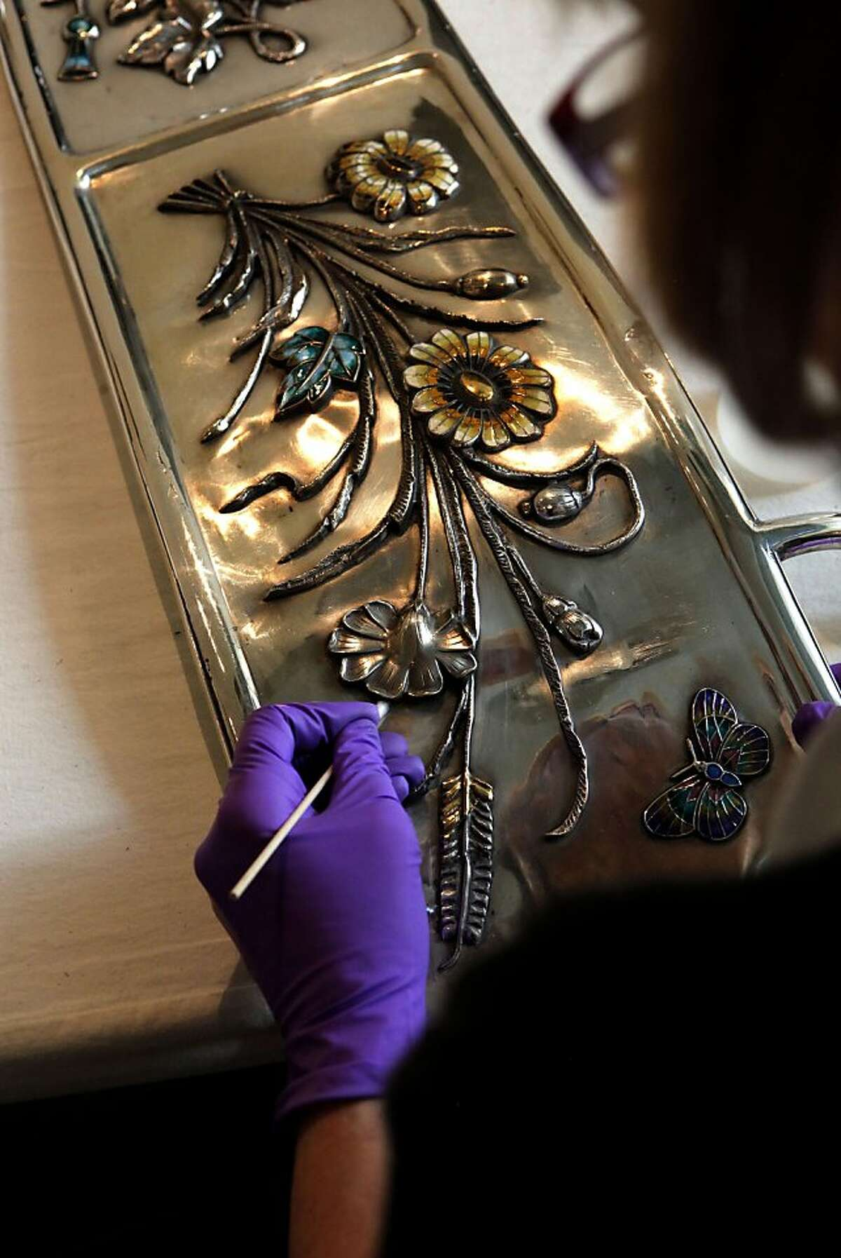 Donna Stevens, a conservator for the V&A Museum in London works on polishing the silver parts for the coach. A silver coach built in 1907 by the Bombay Coach co., was once used by the Maharaja of the Kingdom of Bhavnagarpar India, is part of new exhibit, Maharaja:The Splendor of India's Royal Courts, being installed at the Asian Art Museum, on Friday October 7, 2011, in San Francisco, Ca. This is first time the coach will be on display in the United States. The Asian Art MUseum, faced with a financial crisis, entered into a deal that makes the city of San Francisco liable for its $98 million debt. Now owners say they're trying to turn the museum around with exhibitions designed to appeal to a larger audience, including one drawn up by Pixar animator, Sanjay Patel.