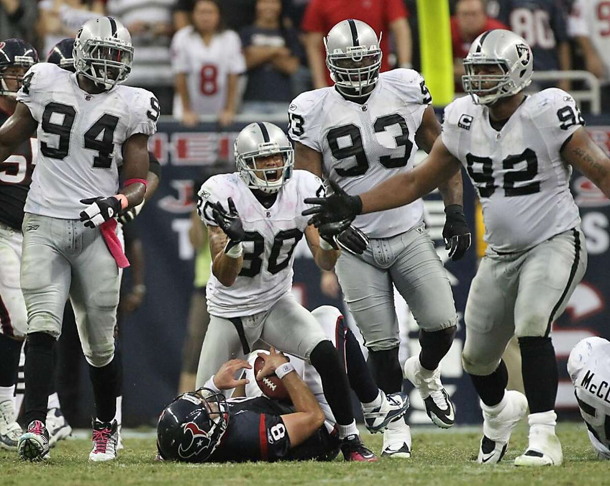 Oakland Raiders defensive back Jerome Boyd (30) and his teammates celebrate sacking Houston Texans quarterback Matt Schaub (8) during the fourth quarter of an NFL football game at Reliant Stadium on Sunday, Oct. 9, 2011, in Houston. The Oakland Raiders won 25-20. ( Nick de la Torre / Houston Chronicle )