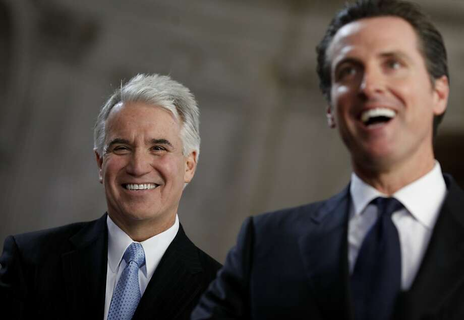 Newly appointed District Attorney George Gascon (left), smiled as he listened to Mayor Newsom (right), talk about the selection process in a ceremony at City Hall. San Francisco Mayor Gavin Newsom appointed Police Chief George Gascon as San Francisco's District Attorney Sunday January 9, 2011.   Ran on: 01-13-2011 Will George Gascón's previous job affect his ability to prosecute cops? Photo: Brant Ward, The Chronicle