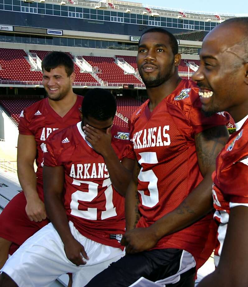 Arkansas running backs, Felix Jones, right, Darren McFadden (5), Michael Smith (21), and Peyton Hillis, left, laugh while posing for a photograph during media day in Fayetteville, Ark., Monday, Aug. 6, 2007. (AP Photo/April L. Brown) Photo: April L. Brown, ASSOCIATED PRESS