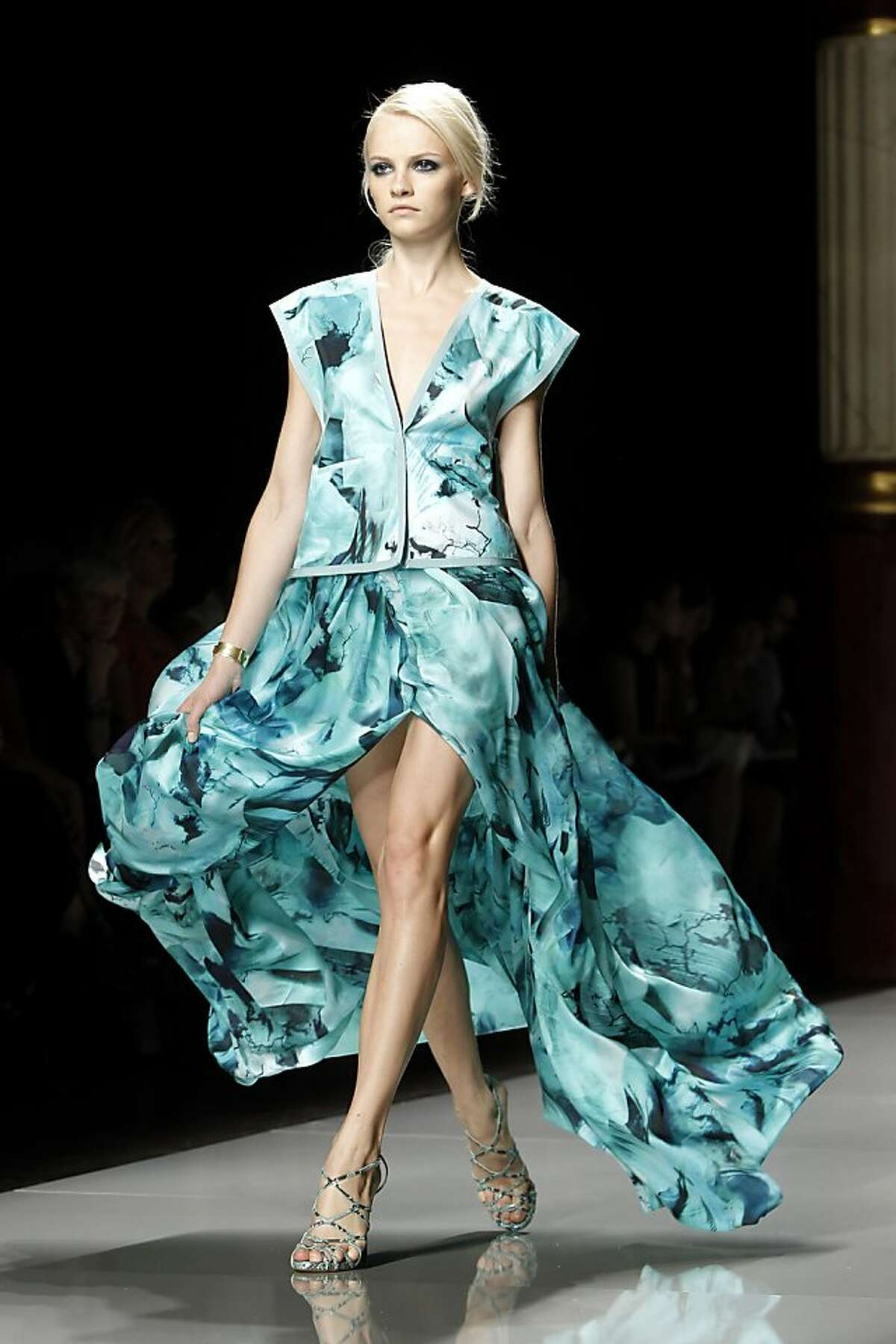 A model wears a creation for Ungaro fashion house's spring-summer 2012 ready to wear collection presented Monday, Oct.3, 2011 in Paris. (AP Photo/Laurent Cipriani)