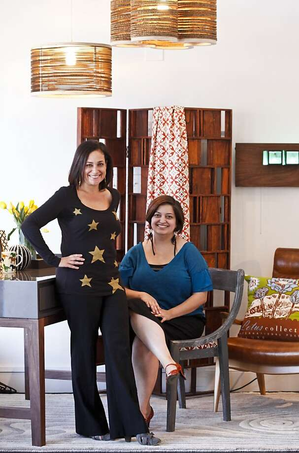 "Aldea Home owner Johanna Bialkin and interior designer Leslie Bamburg are seen on Friday, Sept. 30, 2011 in the office vignette which includes a desk from Bungalow 5, chair from Bungalow 5 with custom Aldea Home fabric collection, leather chair from Dwell Studio, and art light mounted on the wall called, ""Space Waves"" from Liz Koerner, and rug from Global Views.  Recycled cardboard pendent lights are from Shiner international. Photo: Russell Yip, The Chronicle"
