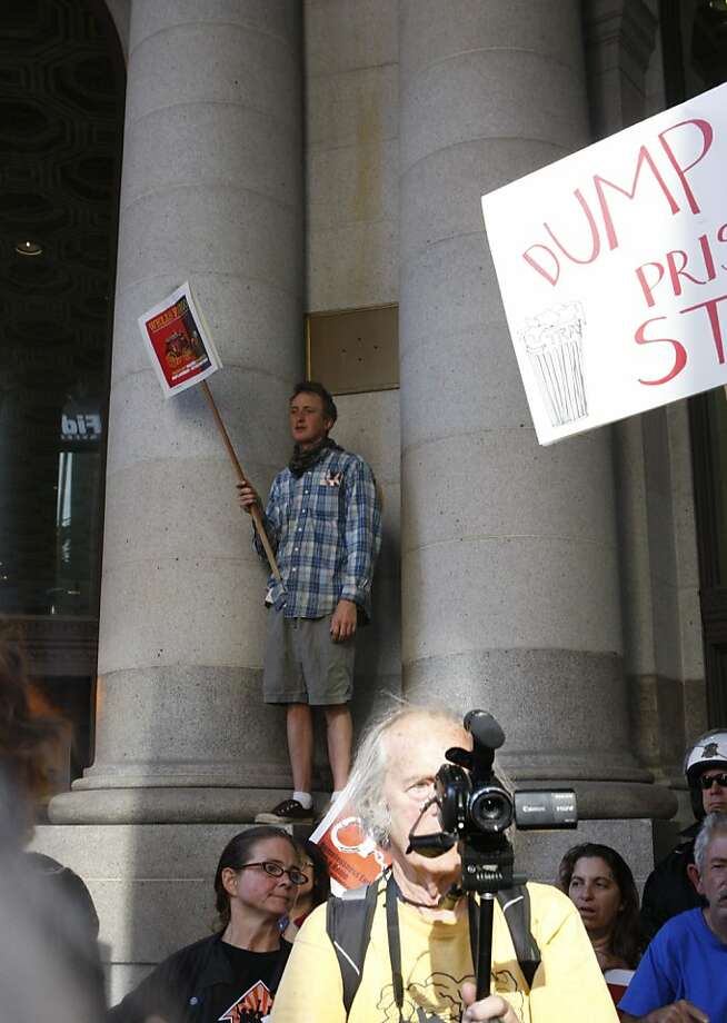 """Protestors cheer in front of Wells Fargo on Friday, August 5, 2011 in San Francisco Calif., to protest what they say is """" Wall Street's role in the financial crisis and the ensuing government divestment in social programs."""" Photo: Michelle Terris, The Chronicle"""