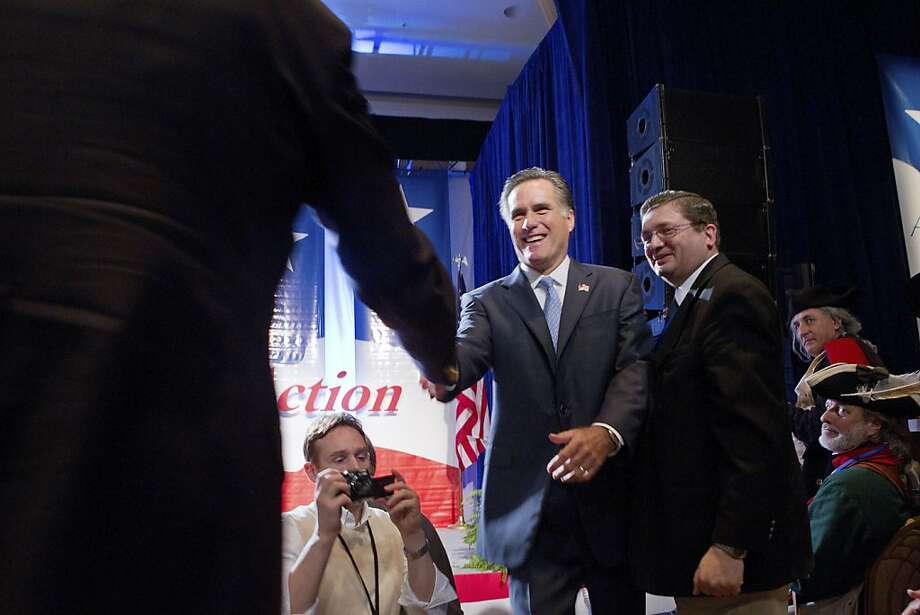 Former Massachusetts Gov. Mitt Romney, a Republican presidential candidate, greets supporters at the Values Voter Summit in Washington, Oct. 8, 2011. The questions about his rightward shift over the years on the topics of most concern to evangelicals have become entangled in the broader challenge for Romney of establishing himself as authentic and principled, and battling the perception that he has reshaped himself for the politics of the moment. (Stephen Crowley/The New York Times) Ran on: 10-09-2011 Former Massachusetts Gov. Mitt Romney, a GOP presidential candidate, faces suspicions from some over his Mormon faith. Photo: Stephen Crowley, The New York Times