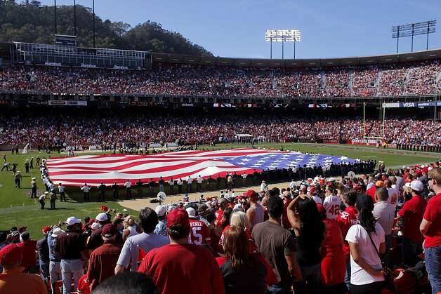 The crowd at the San Francisco 49ers game stand to honor our troops as  the Amearican flag  is draped across the field during half time,  Sunday Oct. 9, 2011, at Candlestick Park in San Francisco, Calif. Photo: Lacy Atkins, The Chronicle