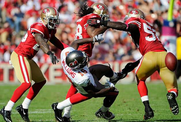 SAN FRANCISCO, CA - OCTOBER 09: Mike Williams #19 of the Tampa Bay Buccaneers gets seperated from the ball by Dashon Goldson #38 of the San Francisco 49ers in the third quarter during an NFL football game at Candlestick Park on October 9, 2011 in San Francisco, California. The 49ers won the game 48-3. (Photo by Thearon W. Henderson/Getty Images) Photo: Thearon W. Henderson, Getty Images