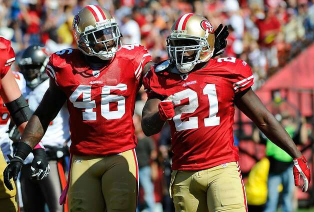 SAN FRANCISCO, CA - OCTOBER 09: Frank Gore #21 and Delanie Walker #46 of San Francisco 49ers celebrates after Gore scored a touchdown against the Tampa Bay Buccaneers in the second quarter during an NFL football game at Candlestick Park on October 9, 2011 in San Francisco, California.  (Photo by Thearon W. Henderson/Getty Images) Photo: Thearon W. Henderson, Getty Images
