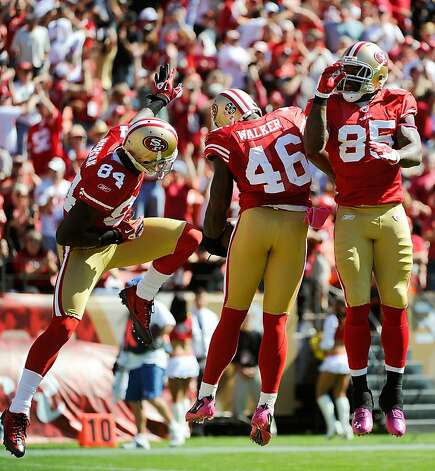 SAN FRANCISCO, CA - OCTOBER 09: Delanie Walker #46, Vernon Davis #85 and Joshua Morgan #84 of the San Francisco 49ers celebrate after Walker caught a twenty six yard touchdown pass against the Tampa Bay Buccaneers in the first quarter during an NFL football game at Candlestick Park on October 9, 2011 in San Francisco, California.  (Photo by Thearon W. Henderson/Getty Images) Photo: Thearon W. Henderson, Getty Images