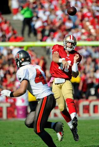 SAN FRANCISCO, CA - OCTOBER 09: Alex Smith #11 of the San Francisco 49ers throws a pass against the Tampa Bay Buccaneers in the third quarter of an NFL football game at Candlestick Park on October 9, 2011 in San Francisco, California. The 49ers won the game 48-3. (Photo by Thearon W. Henderson/Getty Images) Photo: Thearon W. Henderson, Getty Images