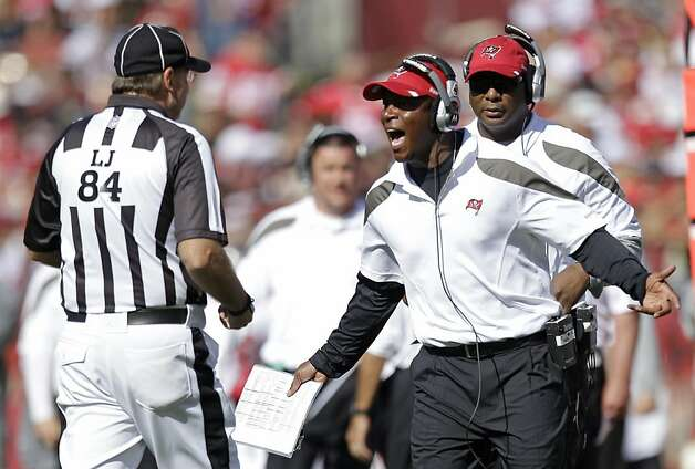 Tampa Bay Buccaneers head coach Raheem Morris right, yells at line judge Mark Steinkerchner, left, during the third quarter of their NFL football game against the San Francisco 49ers in San Francisco, Sunday, Oct. 9, 2011. (AP Photo/Ben Margot) Photo: Ben Margot, AP