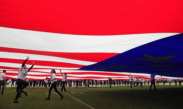 A large flag is carried during halftime of the San Francisco 49ers NFL football game against the Tampa Bay Buccaneers in San Francisco, Sunday, Oct. 9, 2011. (AP Photo/Paul Sakuma) Photo: Paul Sakuma, AP