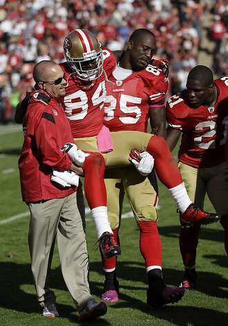San Francisco 49ers wide receiver Josh Morgan, center, is carried off the field by teammate Vernon Davis during the fourth quarter of their NFL football game in San Francisco, Sunday, Oct. 9, 2011. (AP Photo/Paul Sakuma) Photo: Paul Sakuma, AP
