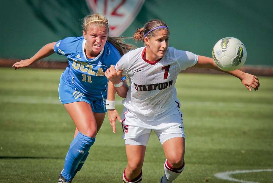 Teresa Noyola of Stanford fights for the ball with Chelsea Cline of UCLA in women's soccer at Cagan Stadium at  Stanford, Calif., on Sunday, October 9, 2011. Photo: John Storey, Special To The Chronicle