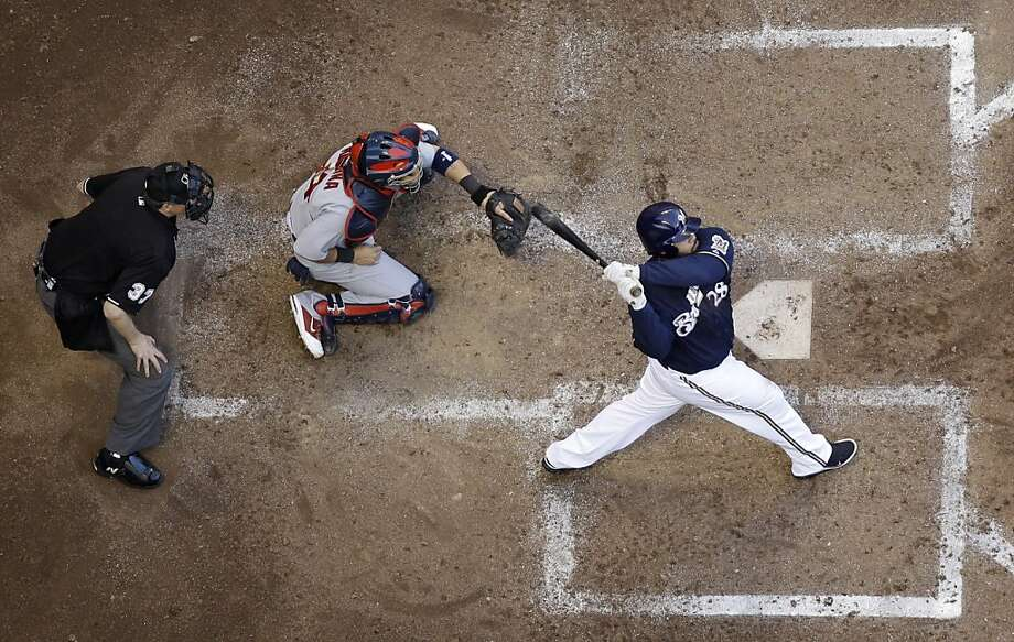 Milwaukee Brewers' Prince Fielder hits a two-run home run during the fifth inning of Game 1 of baseball's National League championship series against the St. Louis Cardinals Sunday, Oct. 9, 2011, in Milwaukee. (AP Photo/Matt Slocum) Photo: Matt Slocum, AP