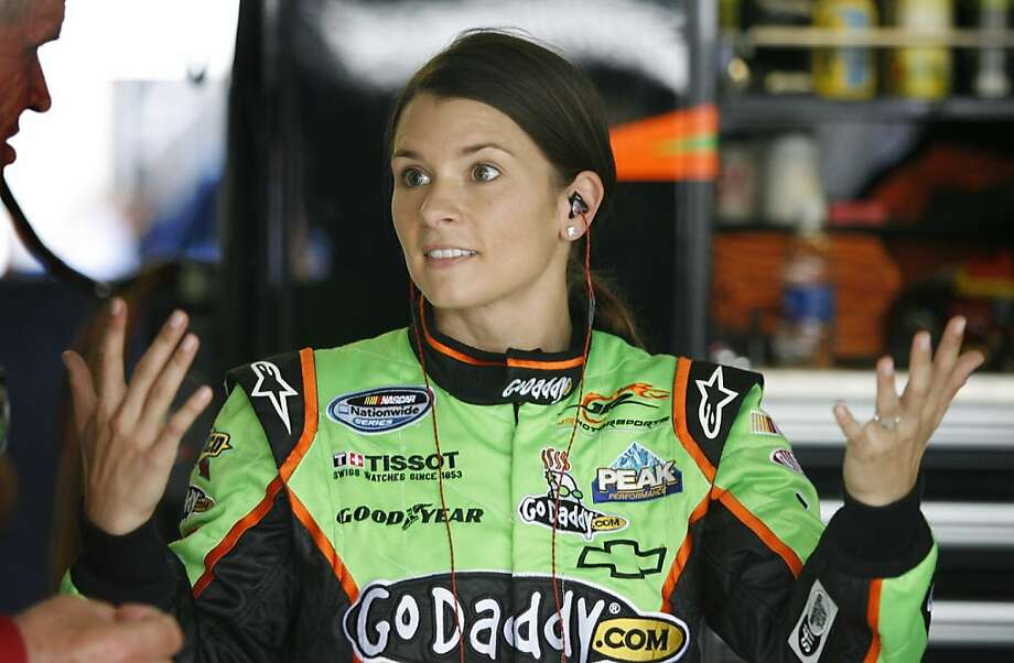 Driver Danica Patrick talks with crew members during practice for the NASCAR Nationwide Series auto race at Kansas Speedway in Kansas City, Kan., Friday, Oct. 7, 2011. (AP Photo/Ed Zurga) Photo: Ed Zurga, AP