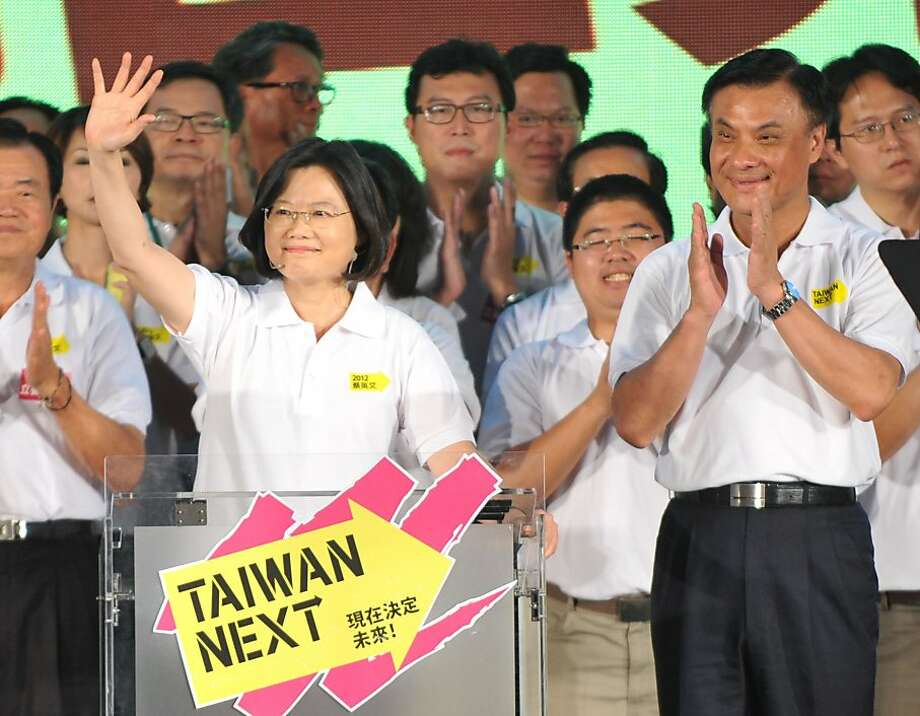 Taiwan's presidential candidate Tsai Ing-wen (L) and her running mate Su Jia-chyuan (R) cheer the crowd at the opposition Democratic Progressive Party's 25th anniversary rally in Taichung, Taiwan on September 24, 2011. Tsai is challenging the incumbent Ma Ying-jeou to become Taiwan's first female president. AFP PHOTO/PATRICK LIN (Photo credit should read PATRICK LIN/AFP/Getty Images) Photo: Patrick Lin, AFP/Getty Images