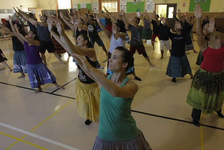 Students in a hula class led by Patrick Makuakane follow along on Sunday, September 18, 2011 in San Francisco, Calif. Makuakane preserves the Hawaiian culture through a performance called The Hula Show 2011,  which debuts in October. Photo: Lacy Atkins, The Chronicle
