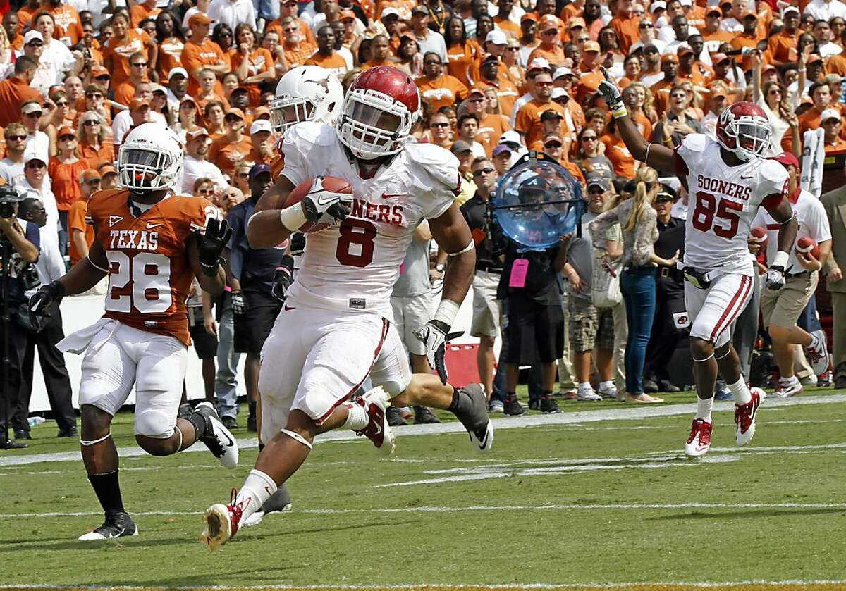 Oklahoma Sooners Dominique Whaley runs for a 64 yard touchdown against the Texas Longhorns during college football action. The Oklahoma Sooners defeated the Texas Longhorns, 55-17, at the Cotton Bowl in Dallas, Texas, Saturday October 8, 2011. (Gregg Ellman/Fort Worth Star-Telegram/MCT)