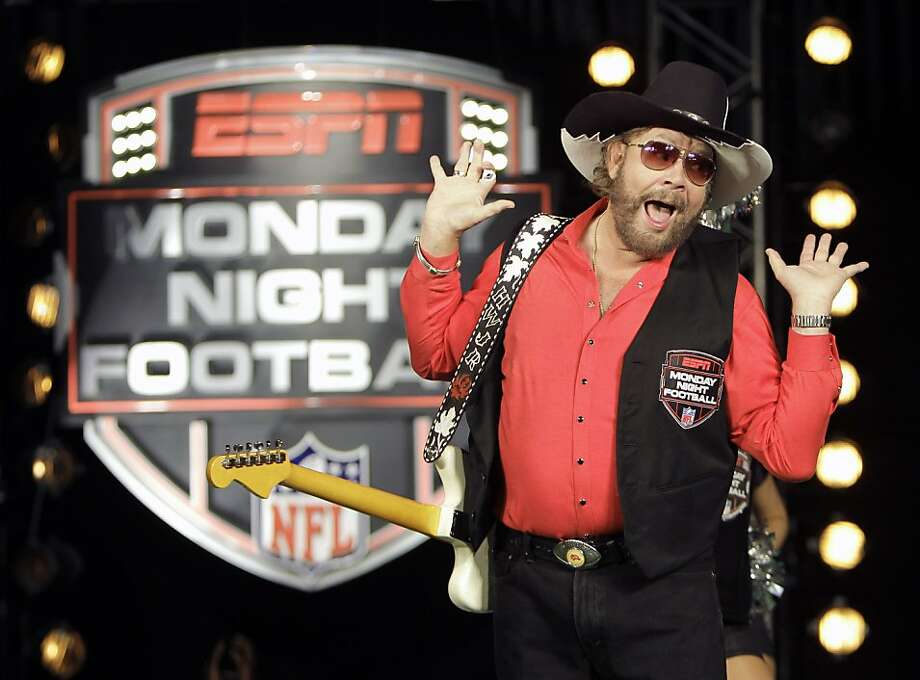 """FILE - In this July 14, 2011, file photo, Hank Williams Jr. performs during the recording of a promo for ESPN's broadcasts of """"Monday Night Football,"""" in Winter Park, Fla. Are you ready for some football? Hank Williams Jr. isn't anymore. The country singer and ESPN each took credit for the decision Thursday morning, Oct. 6, 2011,  to no longer use his classic intro to """"Monday Night Football.""""  The network had pulled the song from the game earlier this week after Williams made an analogy to Adolf Hitler in discussing President Barack Obama on Fox News on Monday morning.  (AP Photo/John Raoux, File)  Ran on: 10-09-2011 An ill-advised comment means &quo;Monday Night Football&quo; fans won't have to watch Hank Williams Jr. sing &quo;All My Rowdy Friends Are Coming Over Tonight&quo; anymore. Photo: John Raoux, AP"""