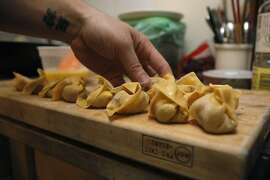 Chef of Bar Agricole Brandon Jew wraps his wontons before putting them in a pot of water to cook as he makes his version of wonton soup in his own kitchen in San Francisco Calif.,  on August 31, 2011.