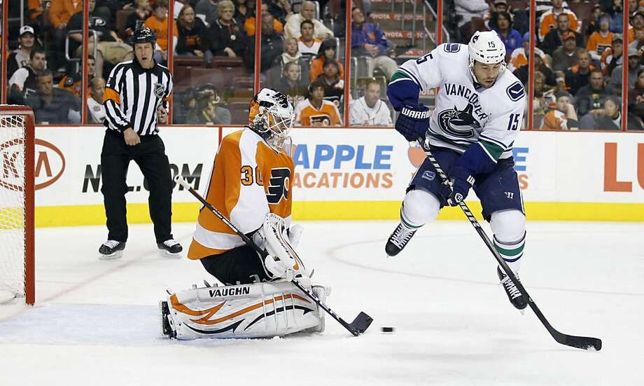 Philadelphia Flyers goalie Ilya Bryzgalov makes the save against Vancouver Canucks' Marco Sturm, right, during the third period at the Wells Fargo Center in Philadelphia, Pennsylvania, on Wednesday, October 12, 2011. The Flyers topped the Canucks, 5-4. (Yong Kim/Philadelphia Daily News/MCT) Photo: Yong Kim, MCT