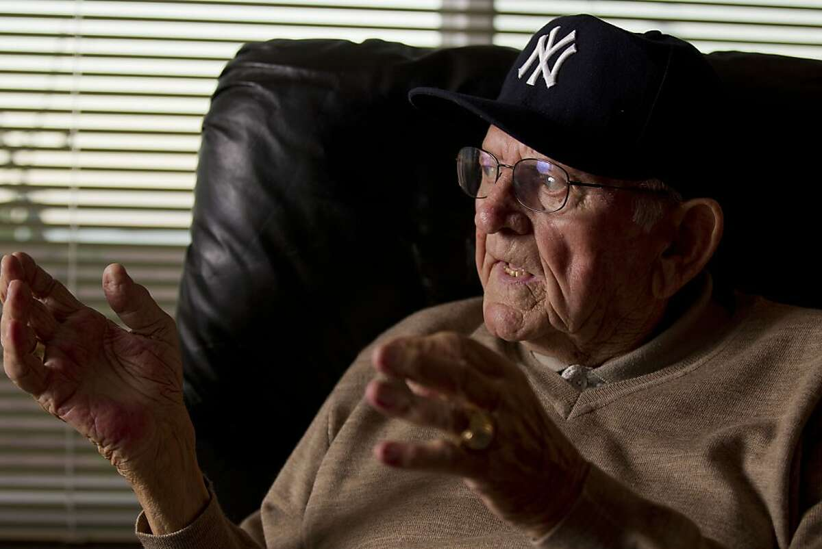 Former Major League catcher Charlie Silvera, gestures as he speaks while watching game 4 of the 2011 American League Championship Series between the Texas Rangers and Detroit Tigers at his home in Millbrae, Calif. on Tuesday, Oct. 11, 2011. Silvera, a San Francisco native, played on the Yankees' championship team in the 50's as a catcher alongside Yogi Berra and Elston Howard and remains active today as a scout.