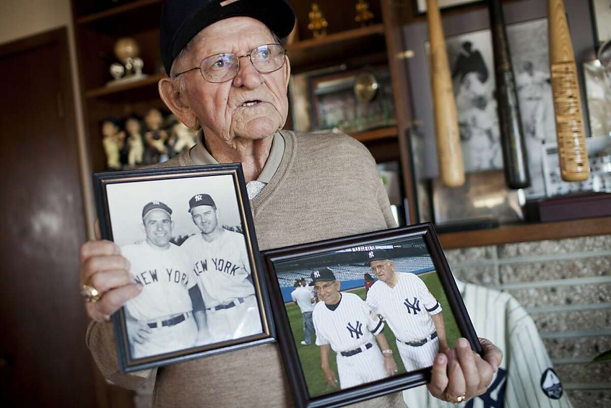 Former Major League catcher Charlie Silvera displays photographs of himself with teammate Yogi Berra at his home in Millbrae, Calif. on Tuesday, Oct. 11, 2011. A San Francisco Native, Silvera played on the Yankees' championship team in the 50's and remains active today as a scout.
