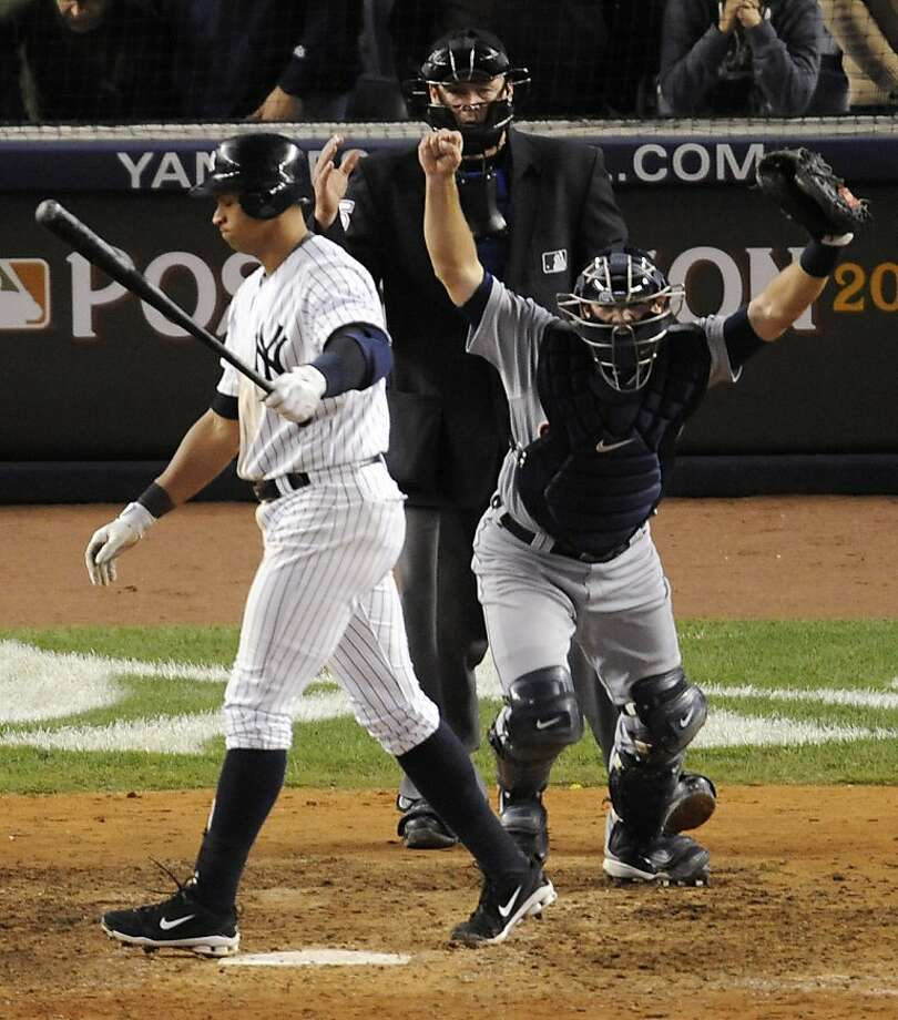 New York Yankees' Alex Rodriguez walks off after striking out to end the game as Detroit Tigers catcher Alex Avila heads for the mound and umpire Ted Barrettt looks on, after Game 5 of baseball's American League division series Thursday, Oct. 6, 2011, at Yankee Stadium in New York. The Tigers won 3-2 to win the series. (AP Photo/Bill Kostroun) Photo: Bill Kostroun, AP