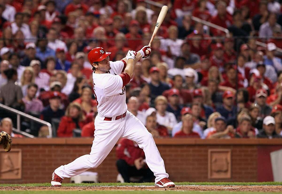 ST LOUIS, MO - OCTOBER 12: David Freese #23 of the St. Louis Cardinals hits a RBI double in the bottom of the first inning against the Milwaukee Brewers during Game Three of the National League Championship Series at Busch Stadium on October 12, 2011 in St Louis, Missouri. (Photo by Christian Petersen/Getty Images)