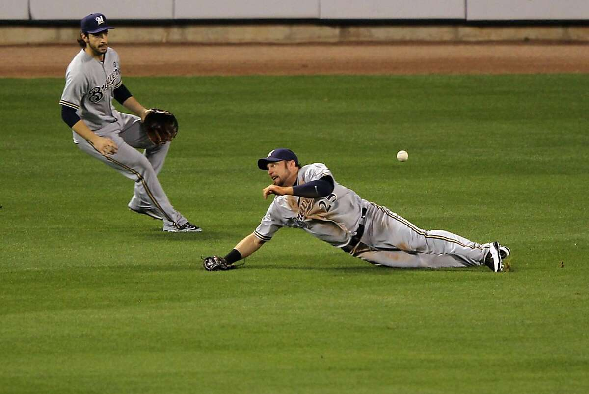 ST LOUIS, MO - OCTOBER 12: Mark Kotsay #25 of the Milwaukee Brewers can't make a play on a double hit by Jon Jay #19 of the St. Louis Cardinals in the bottom of the first inning during Game Three of the National League Championship Series at Busch Stadium on October 12, 2011 in St Louis, Missouri. (Photo by Jamie Squire/Getty Images)
