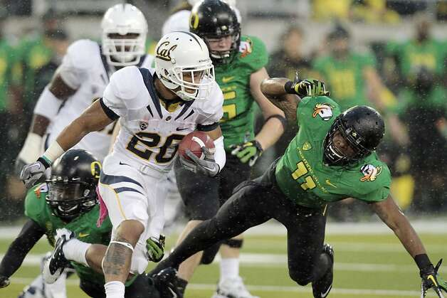 California tailback Isi Sofele (20) gains yardage against Oregon defender Eddie Pleasant, right, during the first half of their NCAA college football game in Eugene, Ore., Thursday, Oct. 6, 2011. (AP Photo/Don Ryan) Photo: Don Ryan, AP