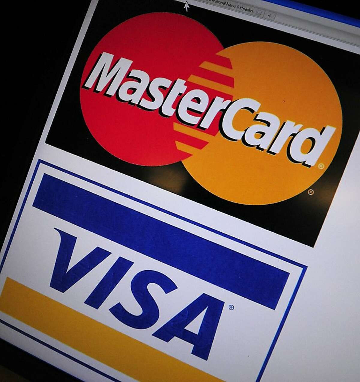 This December 9, 2010 photo shows the logos of credit card giants Mastercard and Visa. The websites Visa and Mastercard were knocked offline December 8 by WikiLeaks supporters, who also took aim at US conservative standard bearer Sarah Palin and a US senator. Visa.com went down instantaneously at 4:00 pm (2100 GMT) as members of the hackers group known as