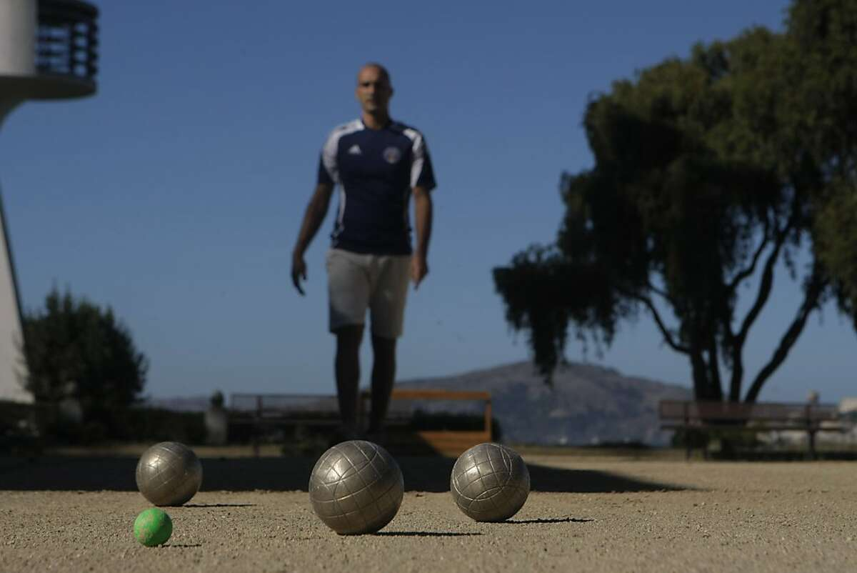 US National Bocce Champion Benji Tosi demonstrates bocce at the Aquatic Park bocce court in San Francisco, Calif., on Monday, Sept. 26, 2011.