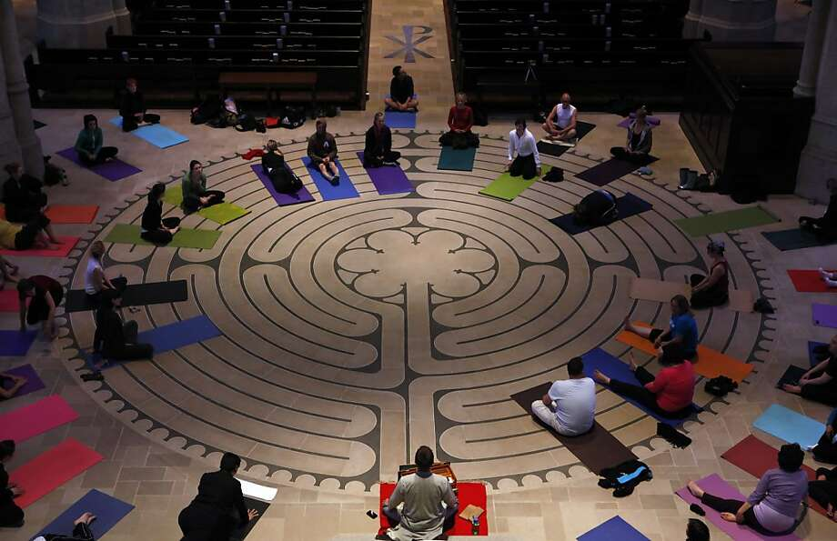 Yoga students prepare for class on the laybrynth of Grace Cathedral on Tuesday, March 30, 2010, in San Francisco, Calif. Every Tuesday evening, 75-100 people roll out yoga mats on the labryinth inside Grace Cathedral for donation-only yoga classes taught by Darren Main. Photo: Carlos Avila Gonzalez, The Chronicle