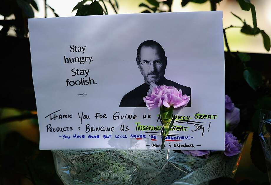 PALO ALTO, CA - OCTOBER 07:  A make shift memorial for Steve Jobs is seen on the sidewalk outside his home on October 7, 2011 inPalo Alto, California. Jobs, who died October 5, 2011 at the age of 56, co-founded Apple in 1976 and is credited with marketing the world's first personal computer in addition to the popular iPod, iPhone and iPad.  (Photo by Kevork Djansezian/Getty Images) Photo: Kevork Djansezian, Getty Images