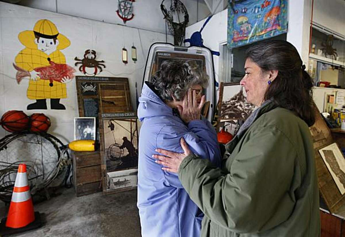 Angela Cincotta (right) comforts her mother Stephanie, matriarch of the family-owned Alioto-Lazio Fish Company, after they announced plans to shut down operations indefinitely in San Francisco, Calif., on Thursday, Jan. 13, 2011, until an extensive oil clean-up project by the Port and Exxon is completed directly behind their building.