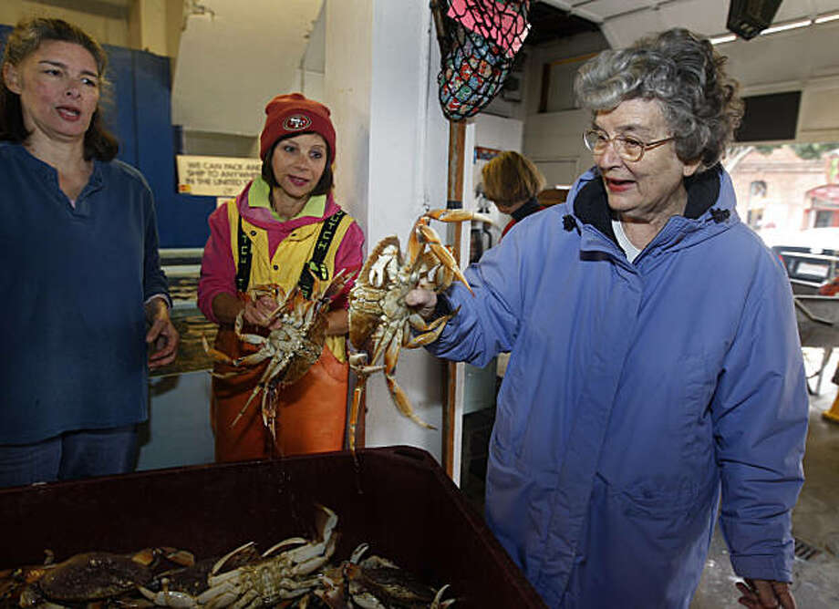 Stephanie Cincotta (right) handles a Dungeness crab with her daughters Angela Cincotta (left) and Annette Traverso (center) at the family-owned Alioto-Lazio Fish Company in San Francisco, Calif., on Friday, Nov. 19, 2010. The Cincotta family has run the business since Stephanie Cincotta's father, Tom Lazio, co-founded the company with Frank Alioto over 50 years ago. Photo: Paul Chinn, The Chronicle