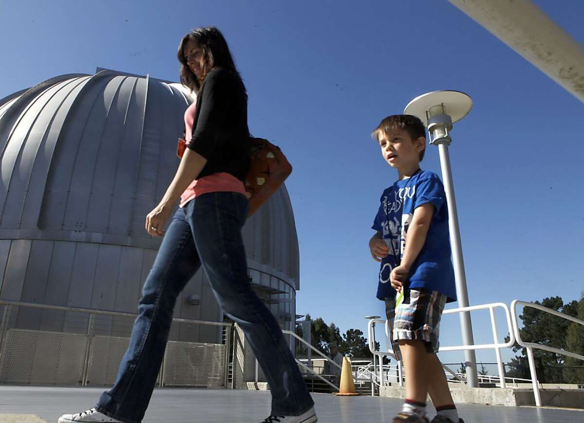 Visitors to Chabot Space & Science Center walk past one of three domes that house the large telescopes. The center is located within Oakland's Joaquin Miller Park Friday October 6, 2011