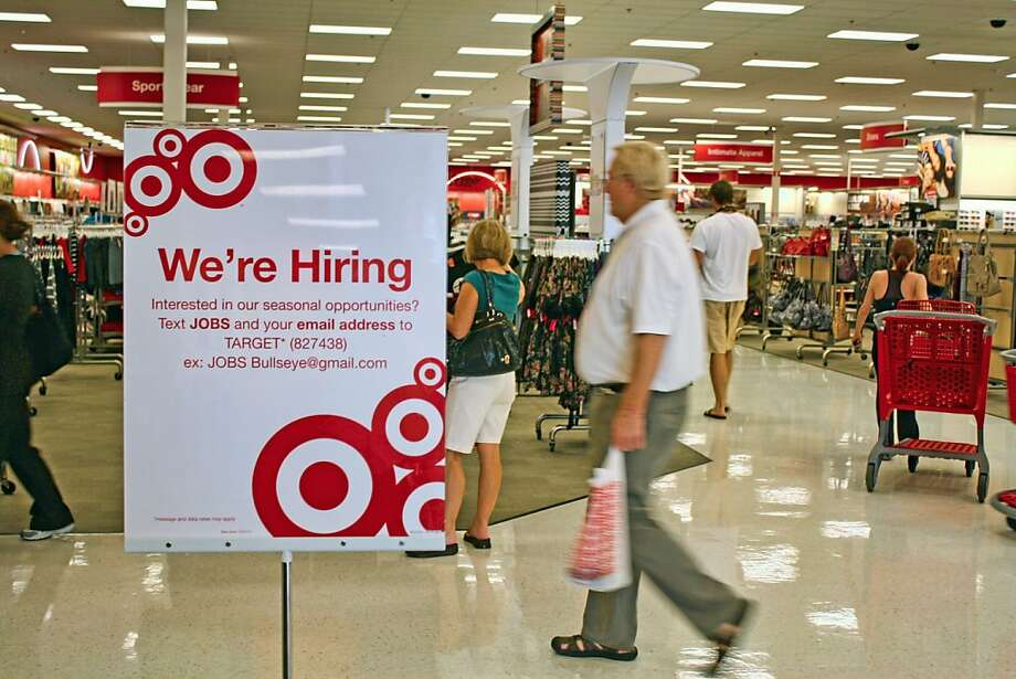 "Target is among the companies using mobile technology to recruit seasonal help. Signs inside select Target locations in South Florida encourage seasonal job seekers to text ""JOBS"" and an email address to ""Target"" (827438) for more information. (Justine Griffin/Sun Sentinel/MCT) Photo: Justine Griffin, MCT"