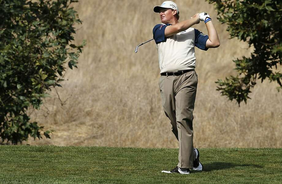 Ernie Els tees watches his approach shot to the 4th hole as he plays in the Pro-Am at the Frys.com Open at the CordeValle Country Club in San Martin, Ca. on Wednesday October 5, 2011. Photo: Michael Macor, The Chronicle