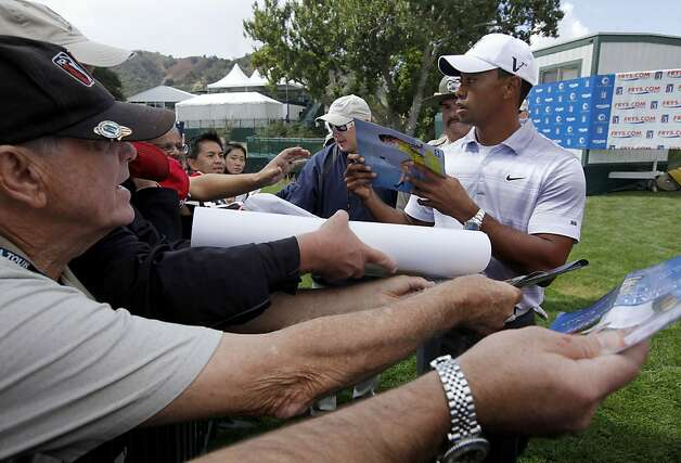 Tiger Woods stops to sign a few autographs after his round in the Pro-Am at the Frys.com Open at the CordeValle Country Club in San Martin, Ca. on Wednesday October 5, 2011. Photo: Michael Macor, The Chronicle