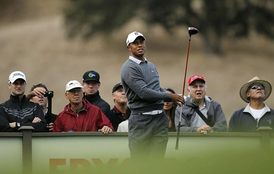 Tiger Woods watches his tee shot on the 9th hole as the Pro-Am gets underway at the Frys.com Open at the CordeValle Golf Club in San Martin, Ca. on Wednesday October 5, 2011. Photo: Michael Macor, The Chronicle