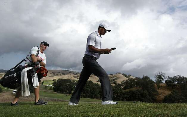 Tiger Woods, followed by his caddie Joe LaCava as they walk from the 6th tee, as the Pro-Am gets underway at the Frys.com Open at the CordeValle Golf Club in San Martin, Ca. on Wednesday October 5, 2011. Photo: Michael Macor, The Chronicle