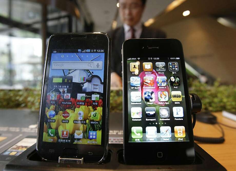 Samsung Electronics' Galaxy S, left, and Apple's iPhone 4 are displayed at the headquarters of South Korean mobile carrier KT in Seoul, South Korea, Friday, April 22, 2011. South Korea's Samsung Electronics Co. says it sued Apple Inc. for patent rights violations, only days after Apple sued Samsung for the same reason.(AP Photo/Ahn Young-joon)  Ran on: 04-23-2011 Samsung, maker of the Galaxy S (left), and Apple, maker of the iPhone 4 (right), are suing each other. Photo: Ahn Young-joon, AP