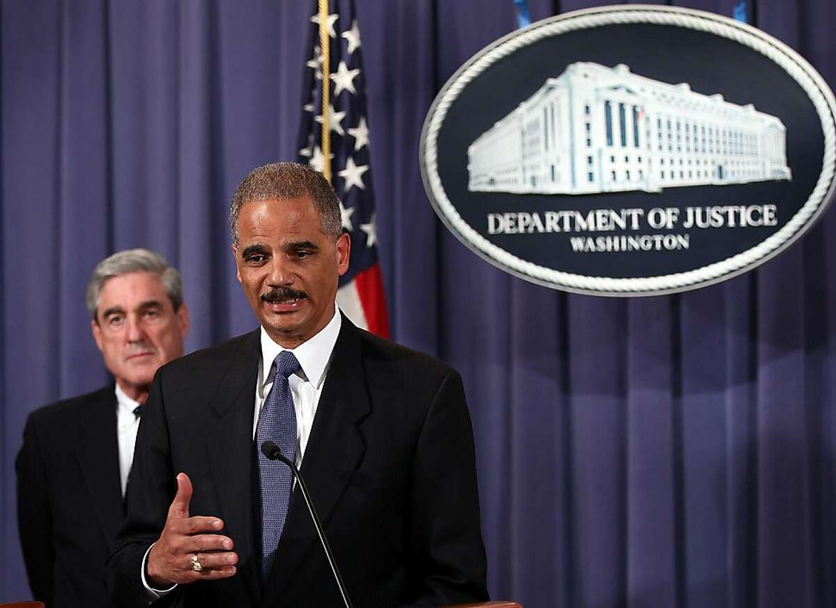 WASHINGTON, DC - OCTOBER 11: U.S. Attorney General Eric Holder (R) and FBI Director Robert Mueller (L) announce a plot was foiled involving men allegedly linked to the Iranian government to kill the Saudi ambassador to the U.S. and to bomb the embassies of Saudi Arabia and Israel in Washington at a news conference October 11, 2011 in Washington, DC. Holder said the men charged with planning the plot were connected to the secretive Quds Force, a division of Iran̥s Islamic Revolutionary Guards Corps. (Photo by Win McNamee/Getty Images)