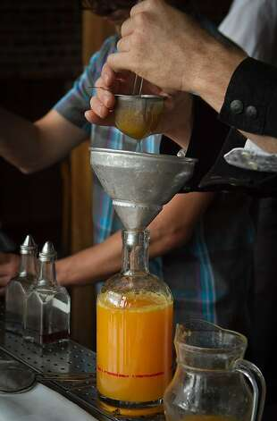 Fresh Orange Juice being strained for brunch at Camino in Oakland, Calif., on Sunday,  October 2, 2011. Photo: John Storey, Special To The Chronicle