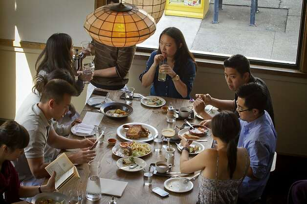 Diners enjoy brunch at Nopa in San Francisco, Calif., on Sunday,  October 2, 2011. Photo: John Storey, Special To The Chronicle