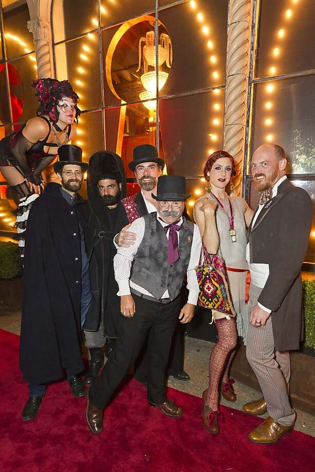 "Interior designer Ken Fulk hosted a party for the launch of his new ground-level interior design boutique at 310 7th St. on Sept. 22, 2011. The party, called ""Peep Show,"" drew 800 well-heeled guests and featured a carnival in a parking lot adjacent the building. Here, carnival performers pose for the camera. Photo: Drew Altizer"